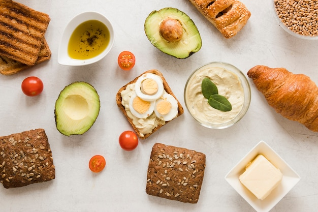 Flat lay toast with hummus eggs and avocado