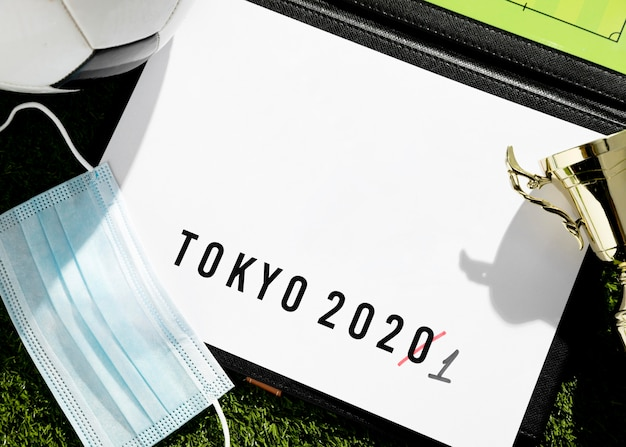 Flat lay tokyo 2020 sports event postponed arrangement