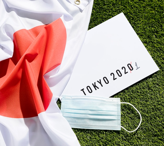 Flat lay tokyo 2020 sports event postponed composition