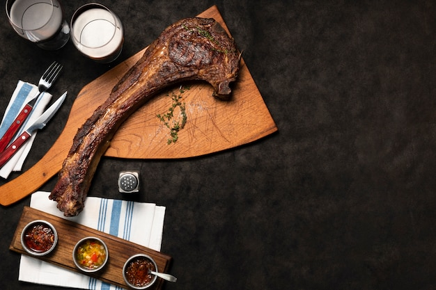 Flat lay tomahawk with drinks