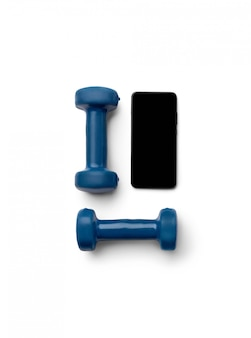 Flat lay top view blue dumbbells and smartphone isolated on white background
