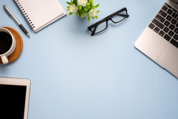 Flat lay top view image of working space ready working equipment  pastel blue color background working desk concept.