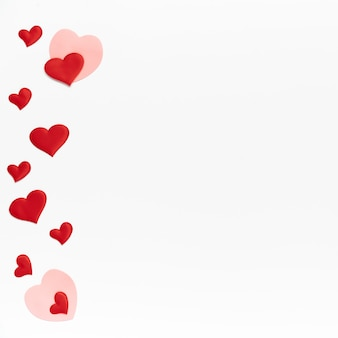 Flat lay, top view. many little colored hearts on white isolated background. template of valentine day with place for text