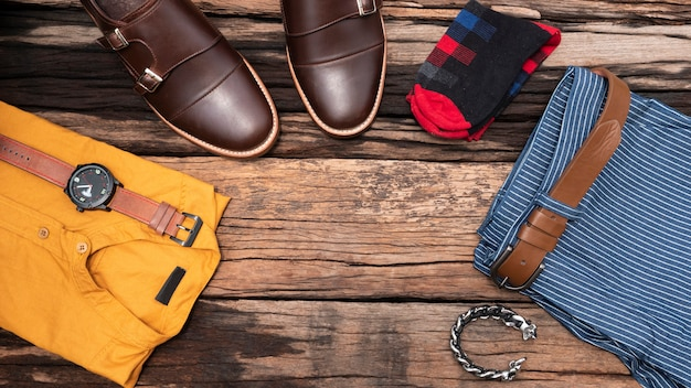 Flat lay, top view, men's accessories and essential travel items