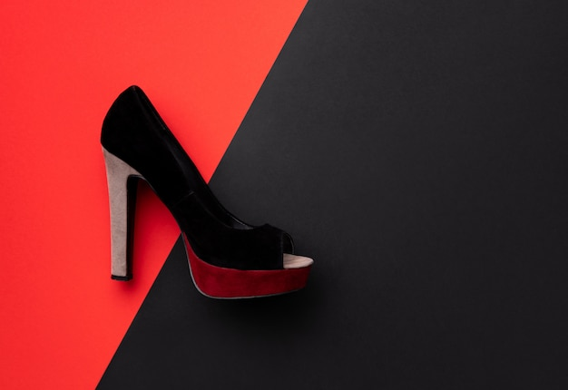 Flat lay top view minimal composition with shoe on double red and black
