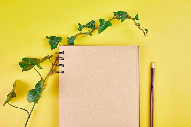Flat lay top view notebook, notes with flowers future family, house, life goals and plan or starting a new business, concept of planning, mock up.