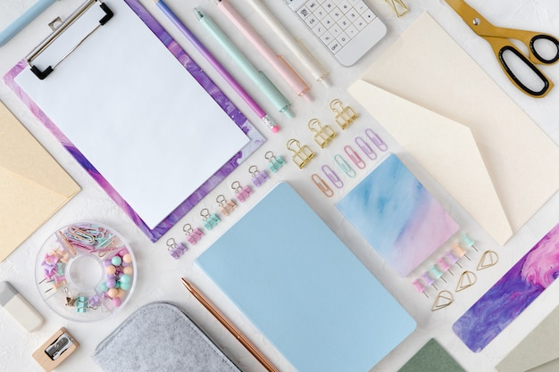 Flat lay and top view of stylish stationery pastel set for school or office.