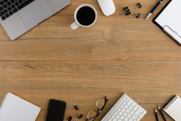 Flat lay, top view wooden office desk workspace