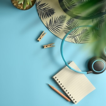 Flat lay, top view workspace blue background. summer stylish traveller blogger concept.