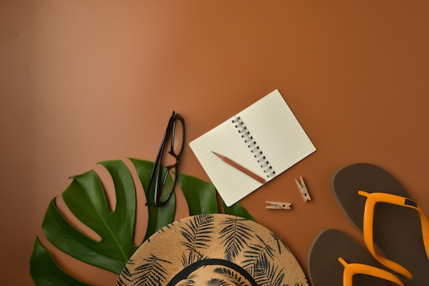 Flat lay, top view workspace on brown background with copy space.