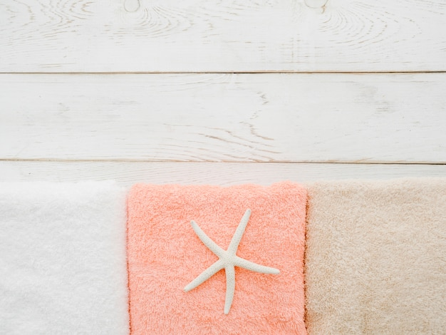 Flat lay towels on wooden background with copy space
