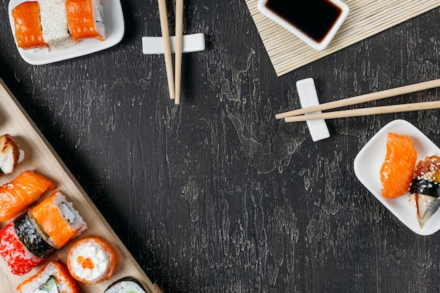 Flat lay traditional japanese sushi with copy space
