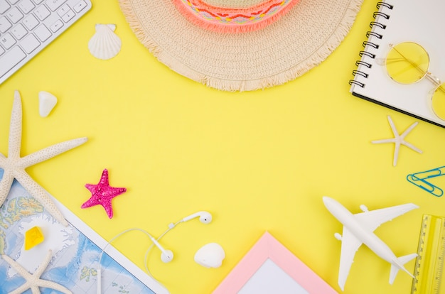 Flat lay of travel accessories on yellow background