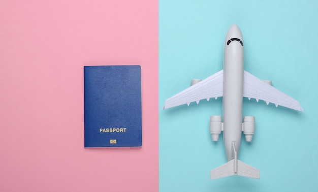 Flat lay travel composition on a blue-pink.