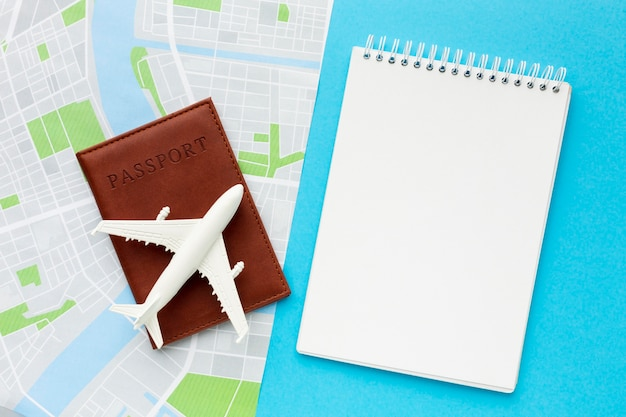 Flat lay travel items on blue background