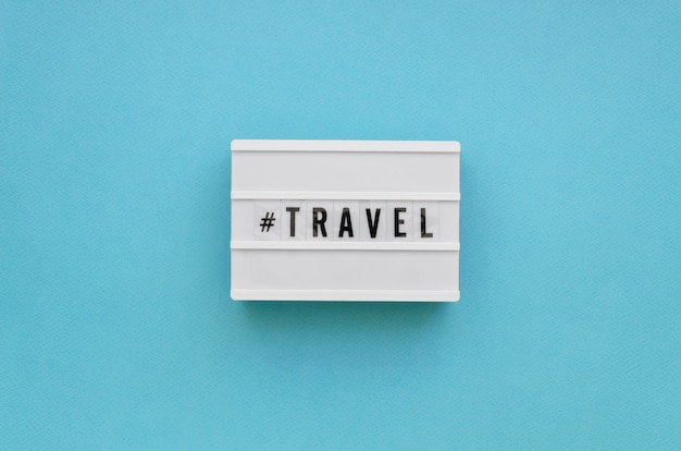Flat lay travel message with blue background