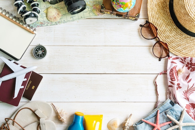 Flat lay traveler accessories  on white wooden table. top view travel or vacation concept.