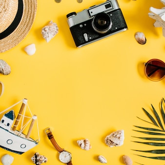 Flat lay traveler accessories on yellow