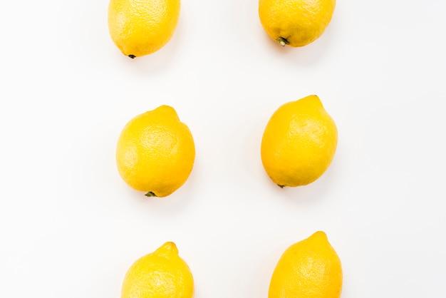 Flat lay of tropical lemons