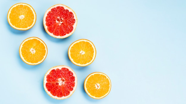 Flat lay of tropical oranges and grapefruits