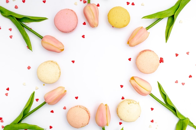 Flat lay of tulips and macarons for valentines day
