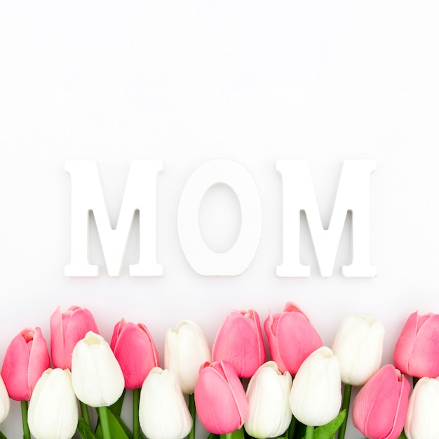 Flat lay of tulips and mom word