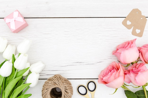 Flat lay of tulips and roses with copy space