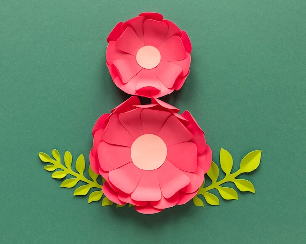 Flat lay of two paper flowers for women's day
