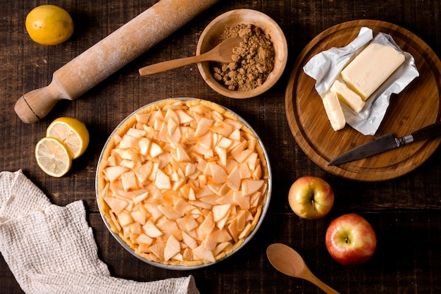 Flat lay of uncooked apple pie with cinnamon