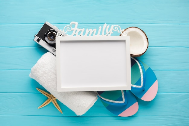 Flat lay vacation composition with photo frame