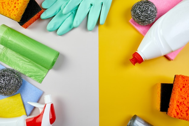 Flat lay of variety house cleaning product on color table, cleaning set for different surfaces, detergents service concept, top view.