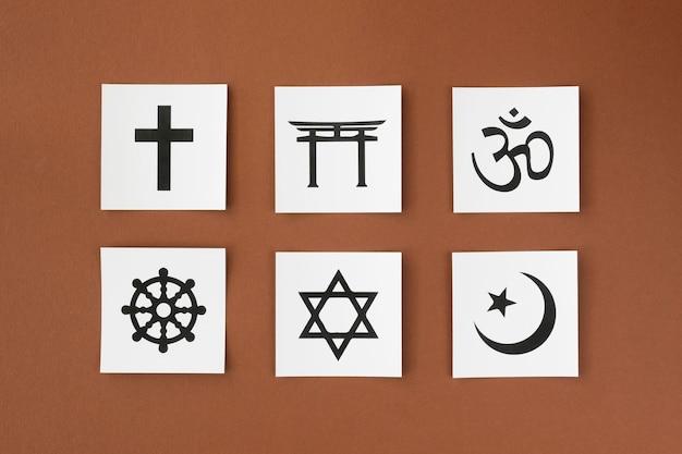 Flat lay of variety of religious symbols