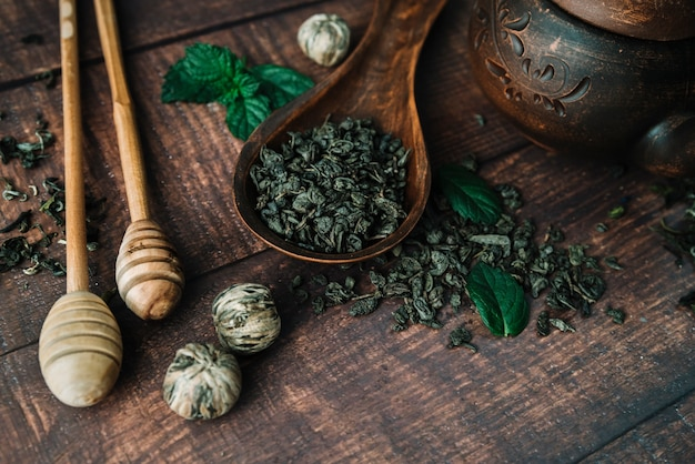 Flat lay variety of tea herbs and honey sticks