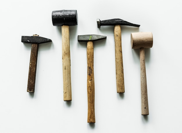 Flat lay of various hammers isolated on white background