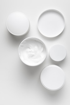 Flat lay various size cream containers