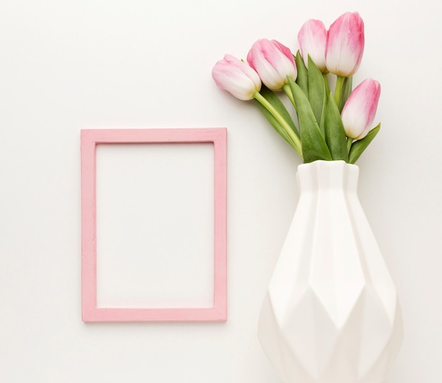 Flat lay vase with tulips