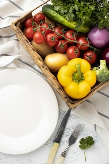 Flat lay vegetables basket and plate