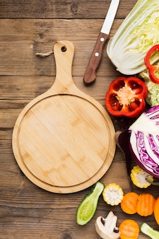 Flat lay vegetables composition on wooden background