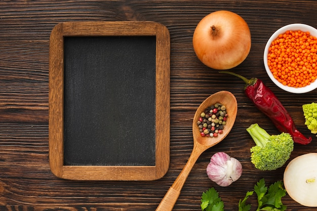Flat lay vegetables mix and blank blackboard