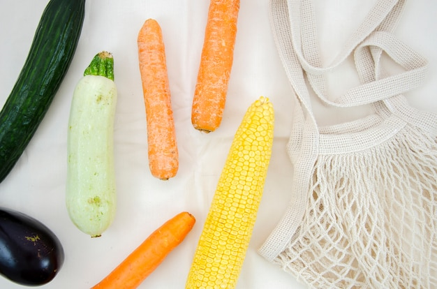 Flat lay vegetables with cotton net bag