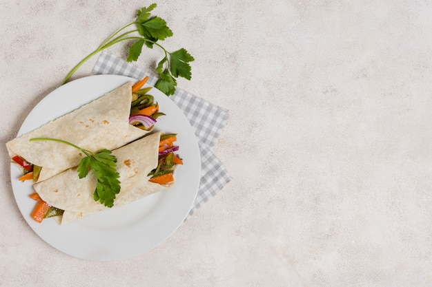 Flat lay of vegetables wraps with copy space