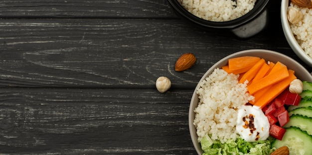 Flat lay veggie salad bowls with couscous and copy-space