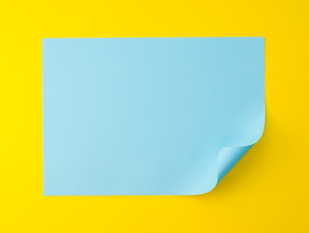 Flat lay of vibrant colored paper sheet with bent corner
