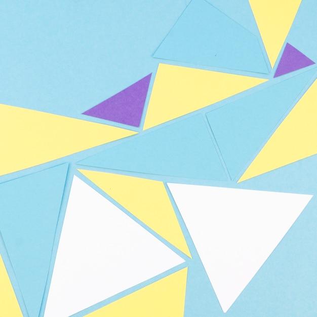 Flat lay of vibrant geometric paper triangles