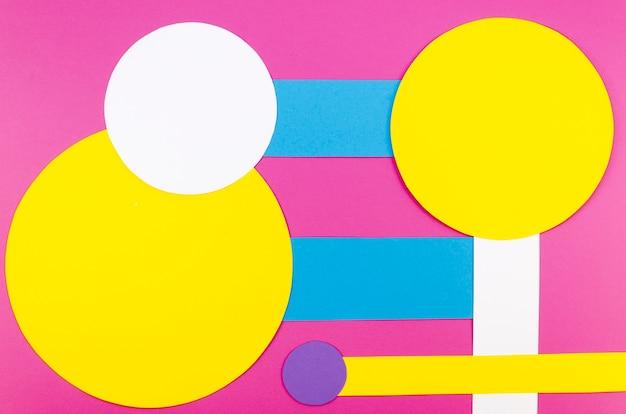 Flat lay of vibrant paper circles and shapes