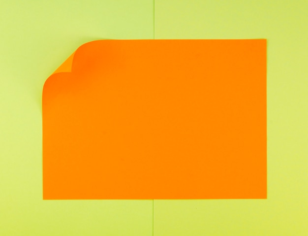Flat lay of vibrant paper sheet with bent corner