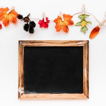 Flat lay of vintage frame and autumn signs