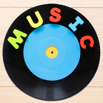 Flat lay vinyl disc with wooden background