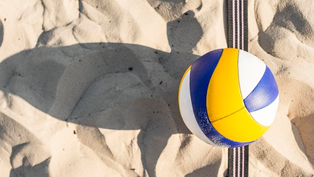 Flat lay of volleyball on the beach sand