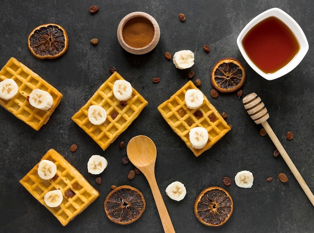 Flat lay of waffles with banana and dried citrus